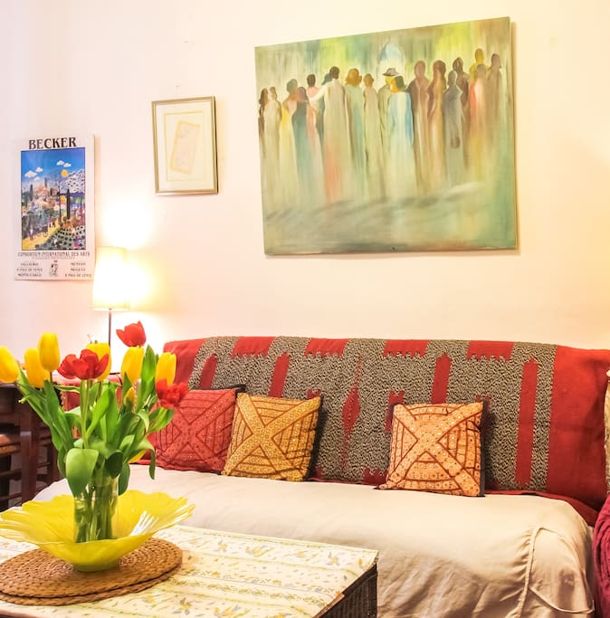 Another view of the couch and artwork