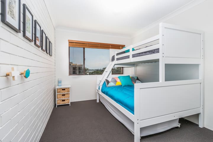 Bedroom 2 has a bunk bed with a double (on bottom). A trundle bed (single) slides out from underneath the bunk. This room sleeps 4.