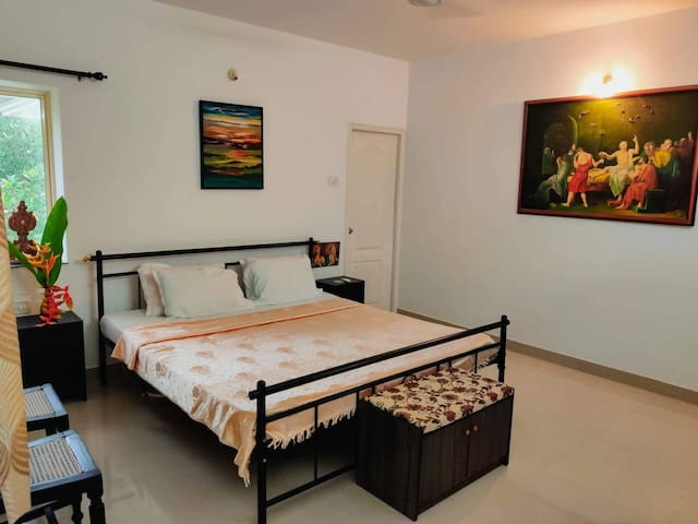Our cozy guest bedroom with an attached bath, and a balcony with a view of the tranquil neighborhood.