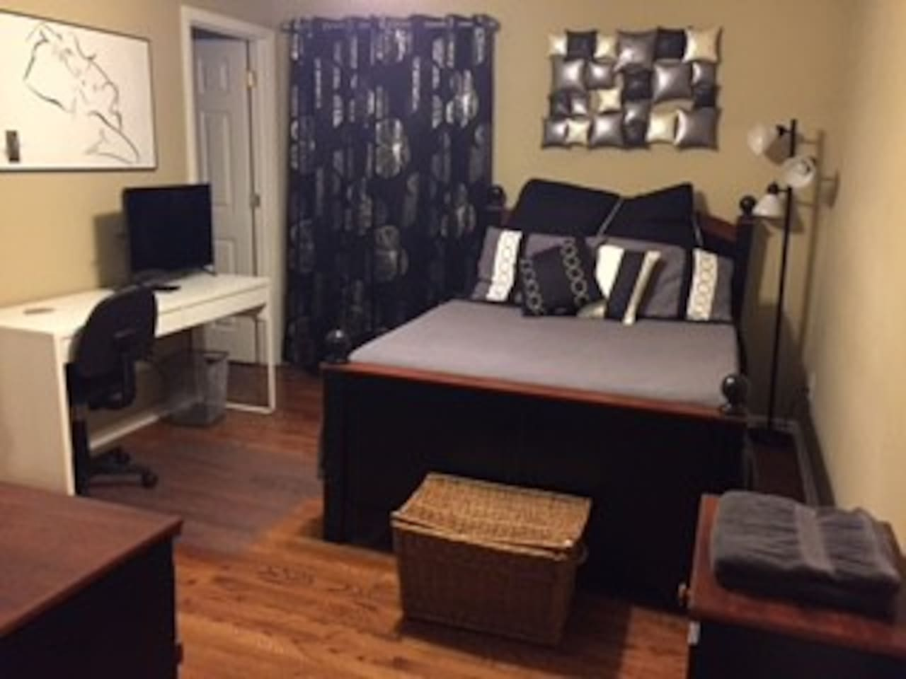 Bedroom - full bed with new mattress Sept '16. Desk, Chair, and TV. The door pictured is to the Walk-in closet.