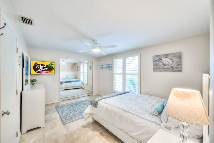 The Master Bedroom comes with a queen bed, smart TV, & large closet.