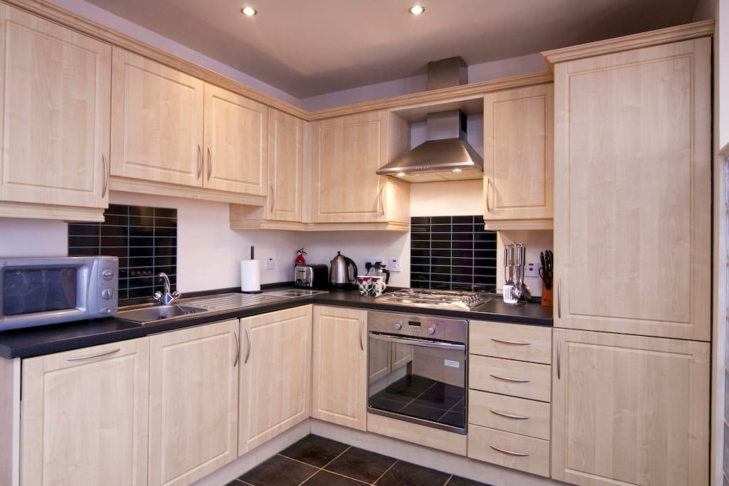 Kitchen with integrated washing machine, dishwasher, fridge/freezer, hob and oven.  Basic cookware and utensils provided.  Kettle, toaster, cafetiere