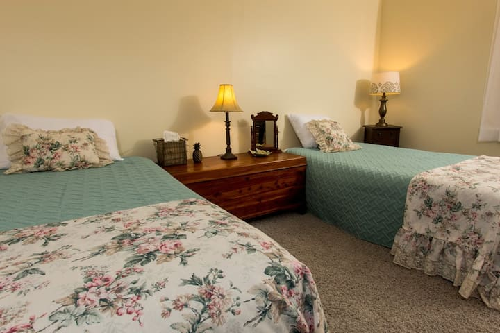 This is Room #6 which  is on the second floor, has 2 twin beds, and shares a bathroom.  This room can only be booked as an add-on to room #5.