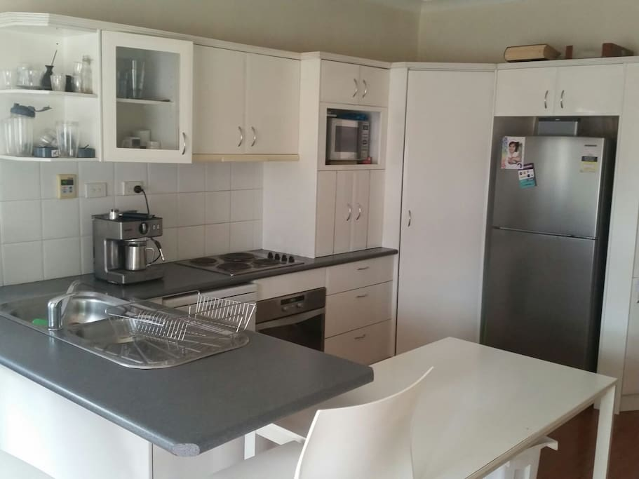 Stainless steal kitchen, neat and tidy. Air conditioner and plenty of space