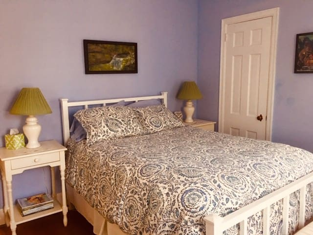 Full size bedroom.  Very comfortable bed and lots of natural light with view onto front garden.