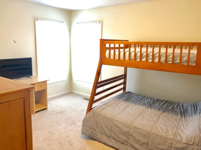 Fourth bedroom with full sized bed on lower bunk and twin sized top bunk comfortably sleeps three.