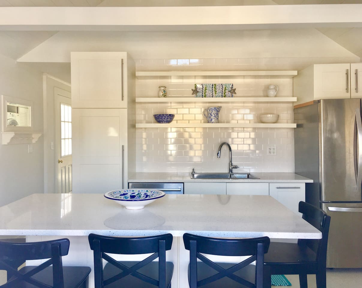 Kitchen with island and cathedral ceiling