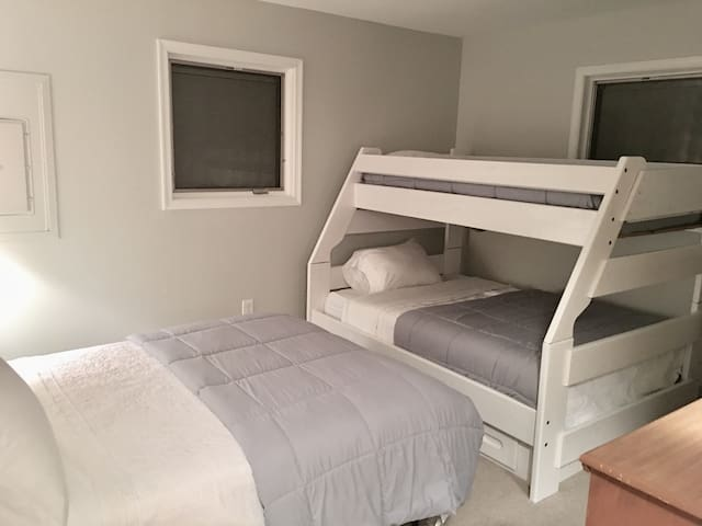 Bedroom #2: Twin over full bunk bed and a separate full size bed. Large room great for 4-5 kids. Closet, dresser, blow dryer, full length mirror.