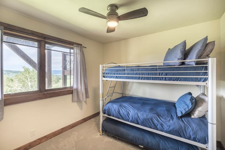 4th bedroom is the Bunk Room with 3 twin beds. The bunkroom has it's own bathroom as well.