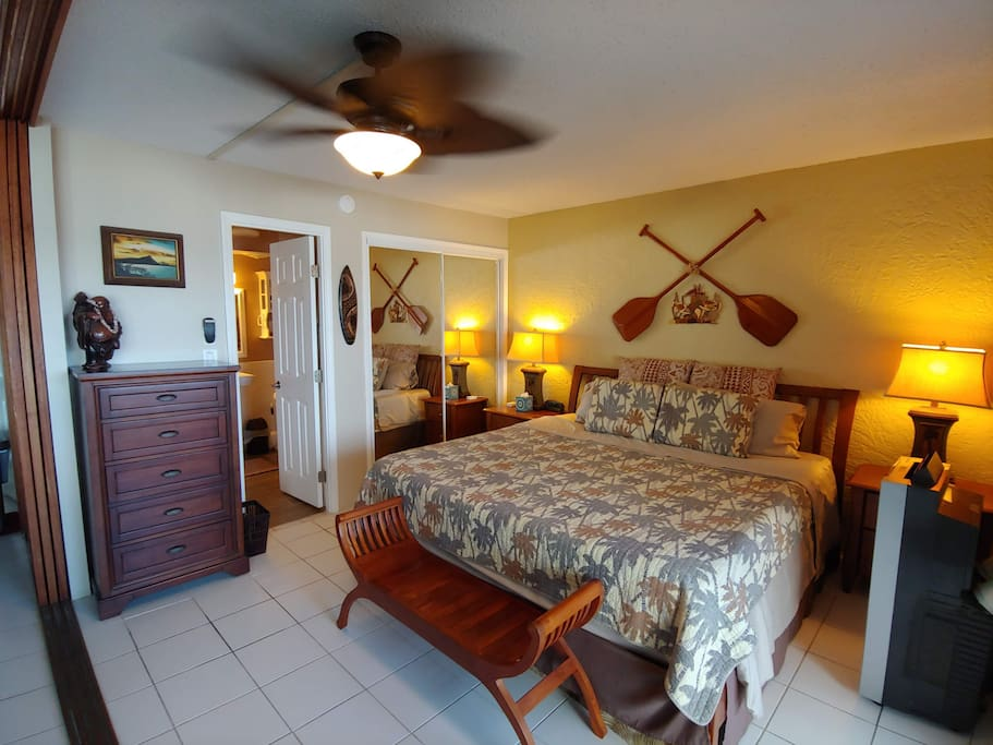 Master bedroom with Tommy Bahama decor and ensuite bathroom