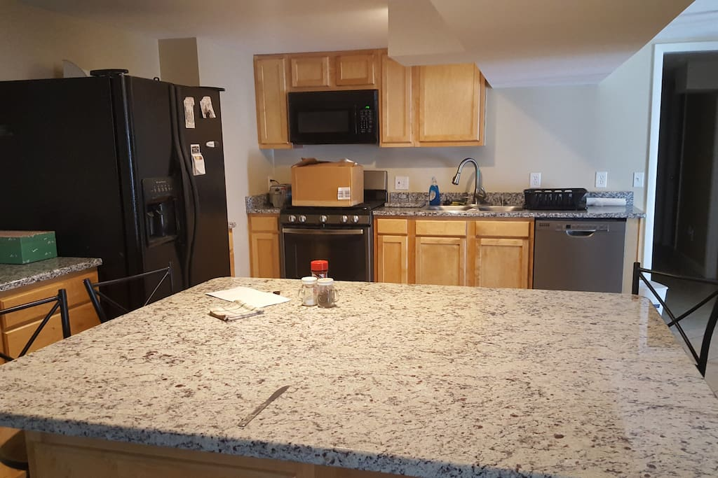 Full Kitchen. Includes Coffee Maker, stove, oven, microwave, dishwasher, pots, pans, plates, silverware, all the comforts of home