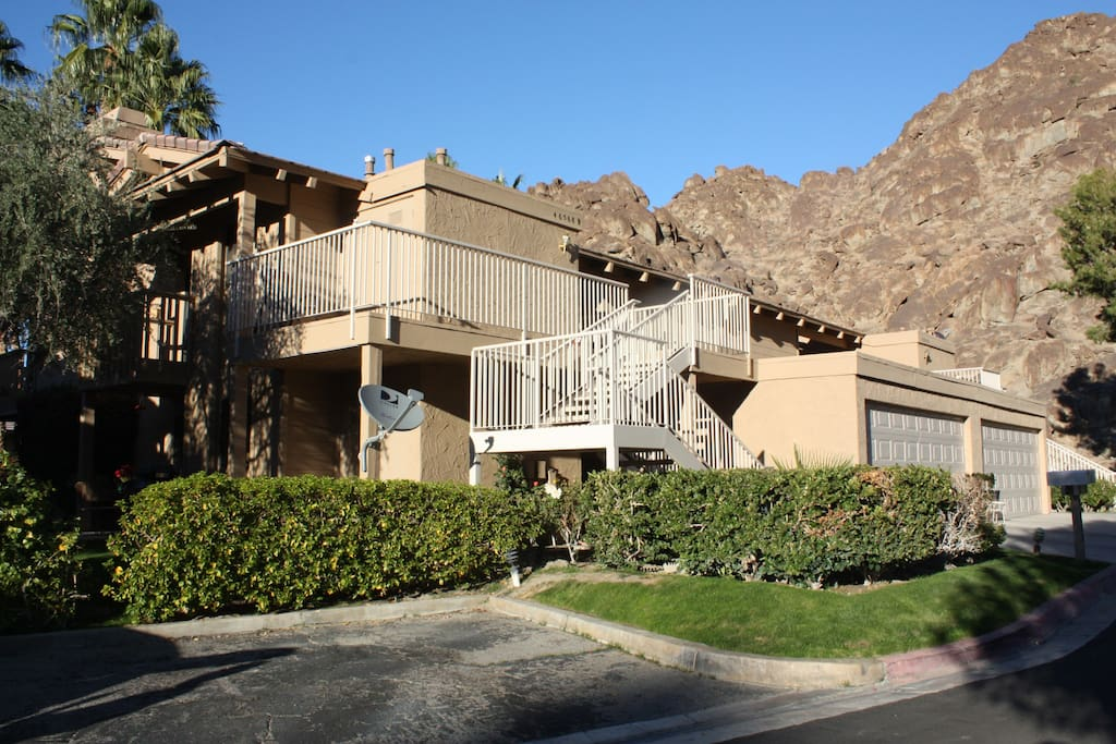Front of condo nestled among the mountains