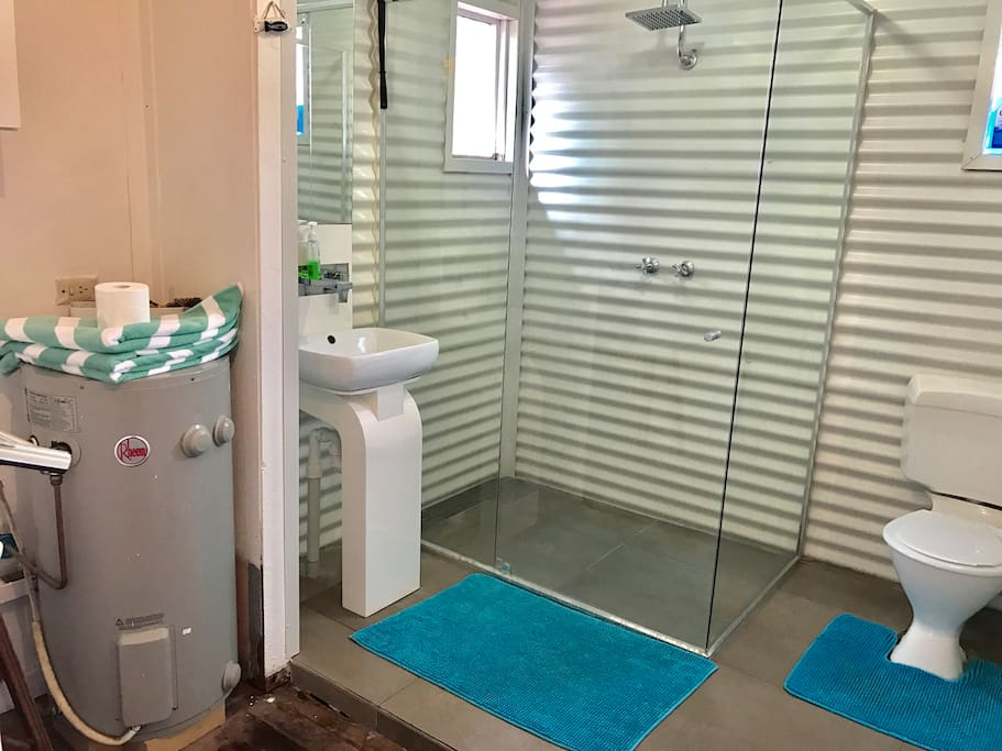 The main bathroom in house is very spacious. With massive shower and a beach theme it really feels like your away on holidays:)