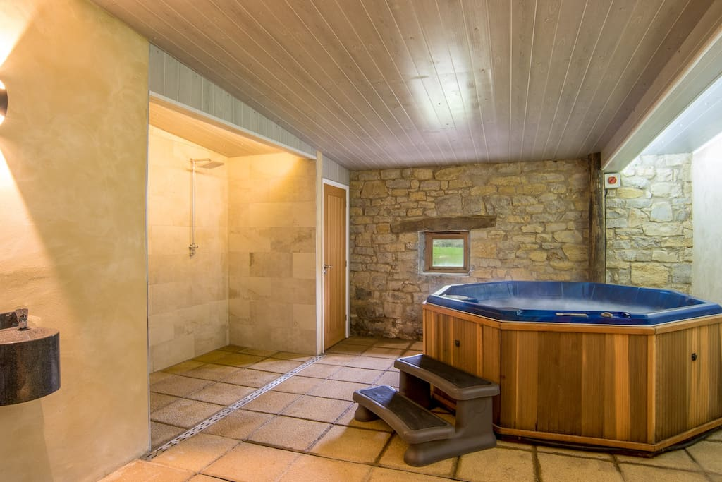 New Spa Room with hot tub and infrared sauna, a peaceful area to relax, spa treatments available.