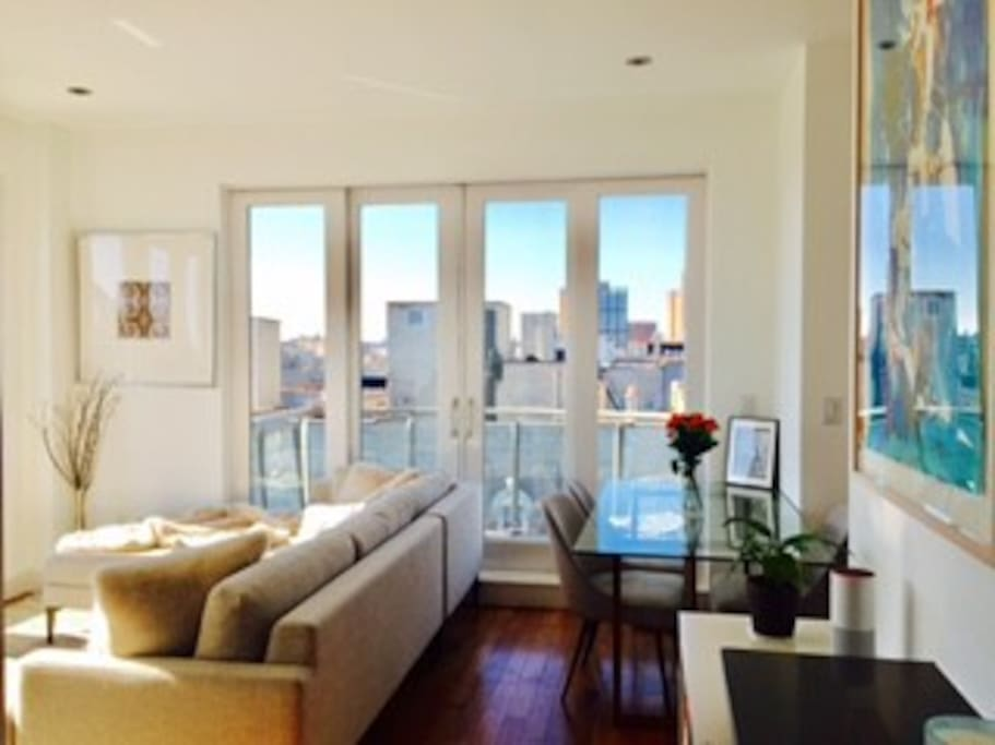 Living room. Doors open up to furnished private patio with awesome views.