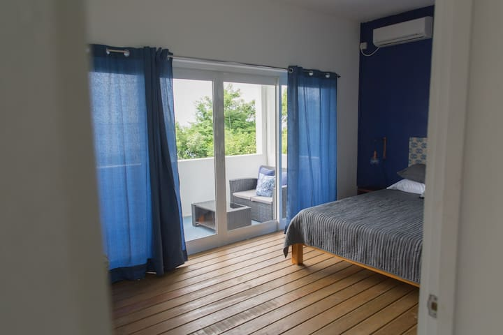Bedroom with sea view leads on to the balcony