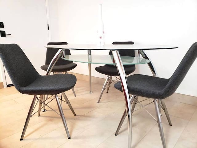 Top of the line, ultra modern dining and work table. Wool chairs from Soho Concepts.