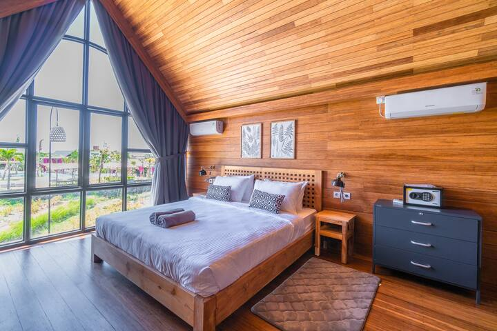Comfy double bed, facing the rice paddies