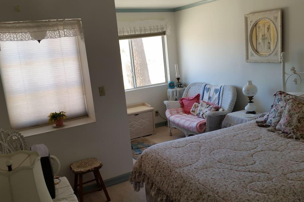 Bedroom has two west-facing windows.