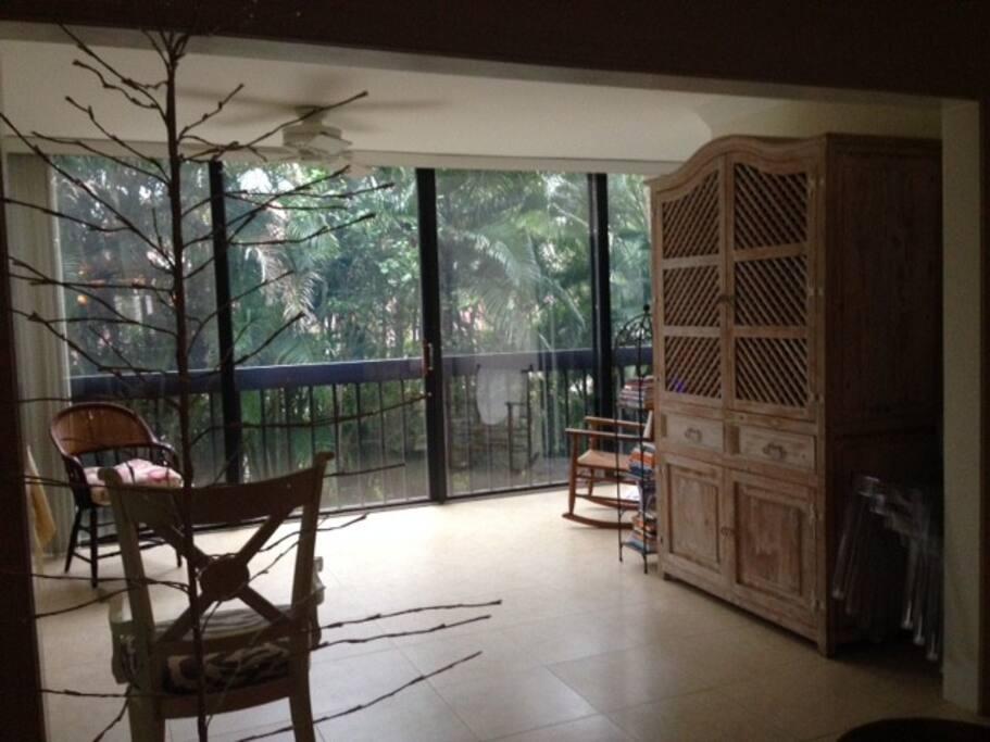 Enclosed porch, garden and river views