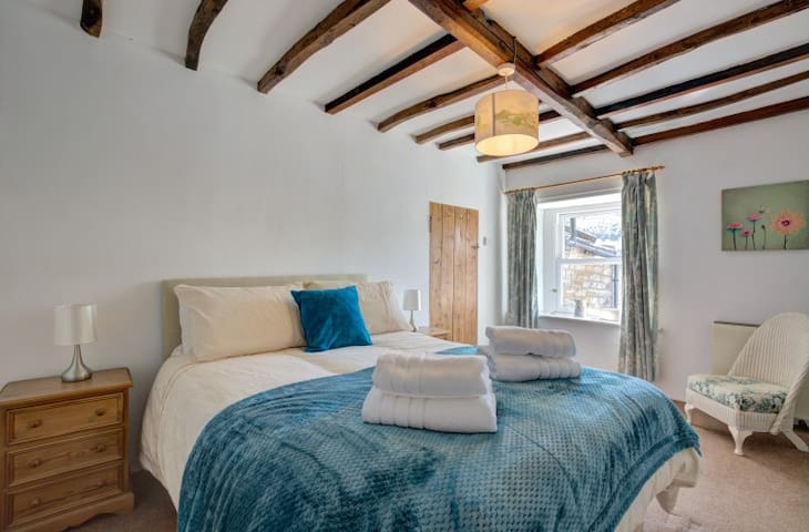 Master bedroom with wonderful views - Double Room with space for travel cot.