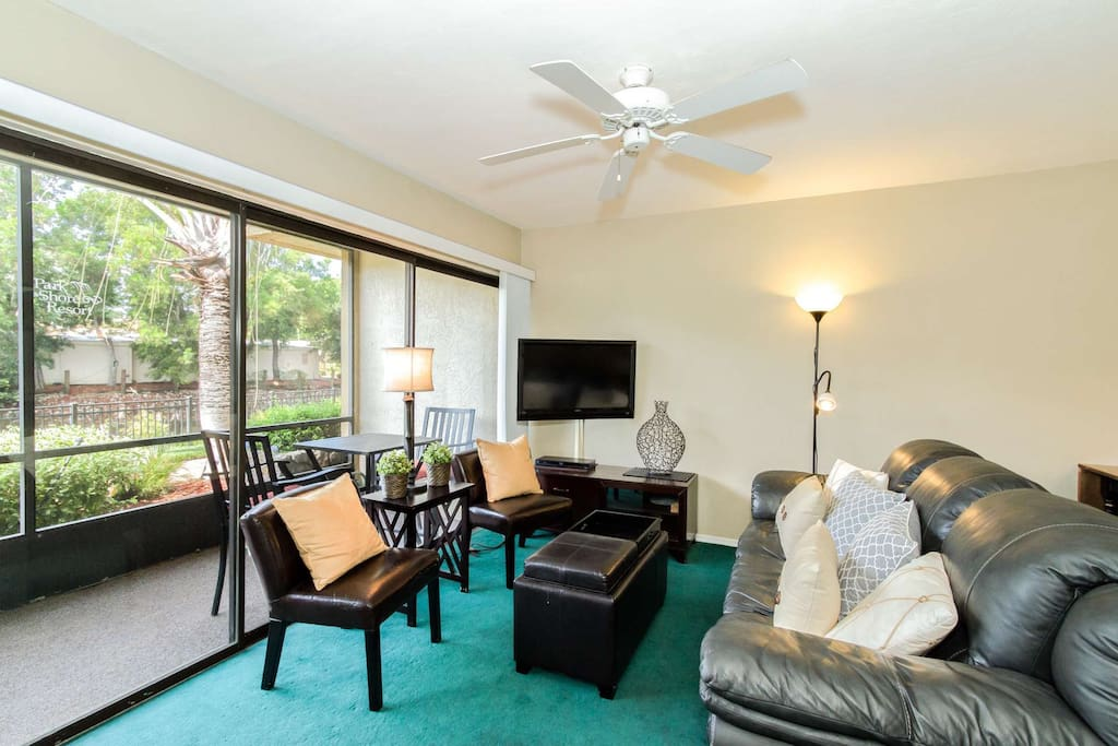 Cozy comforts of home with large flat screen TV & direct views of the water from your vacation living space.