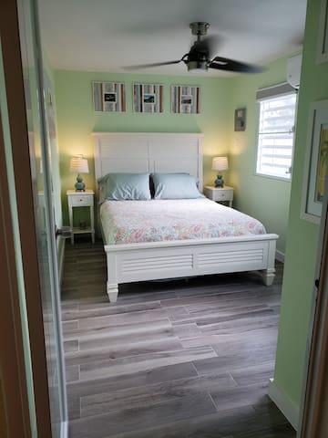 Master bedroom w/ queen bed & whisper quiet AC.