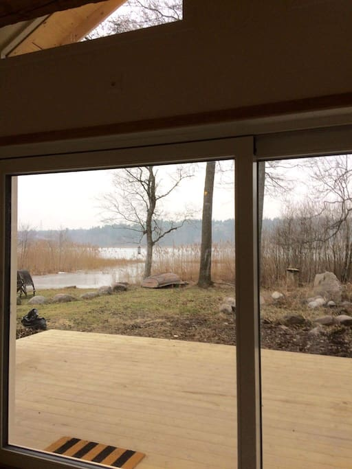 Panorama window to the lake. Just slid the door to go outside.