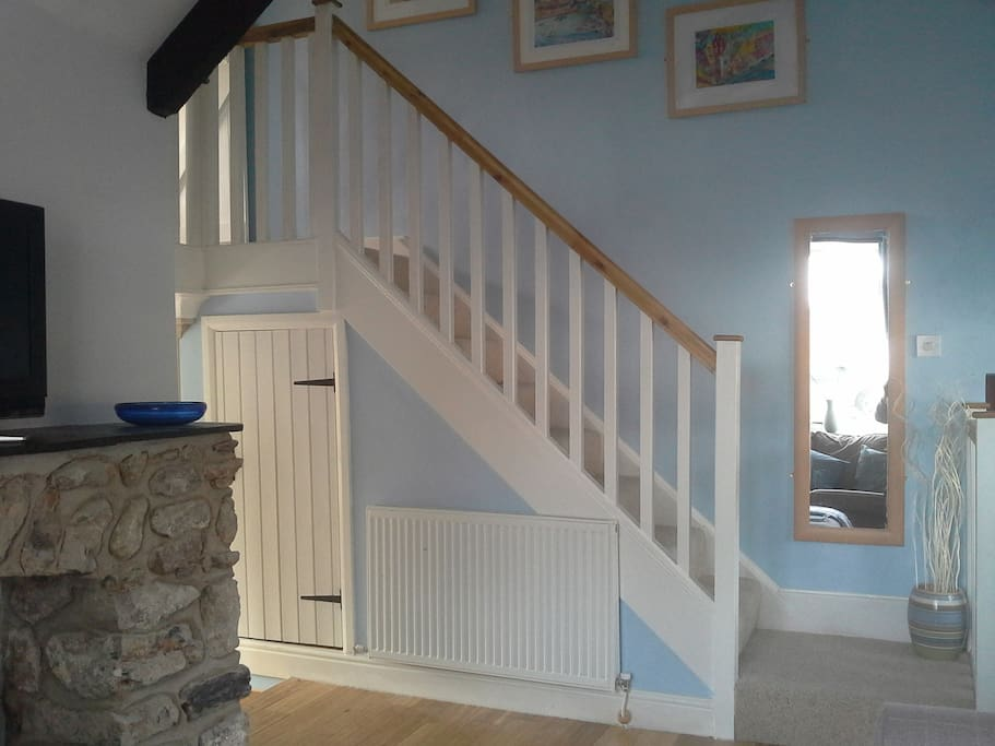 Carpeted stairs up to Double and Bunk bedrooms