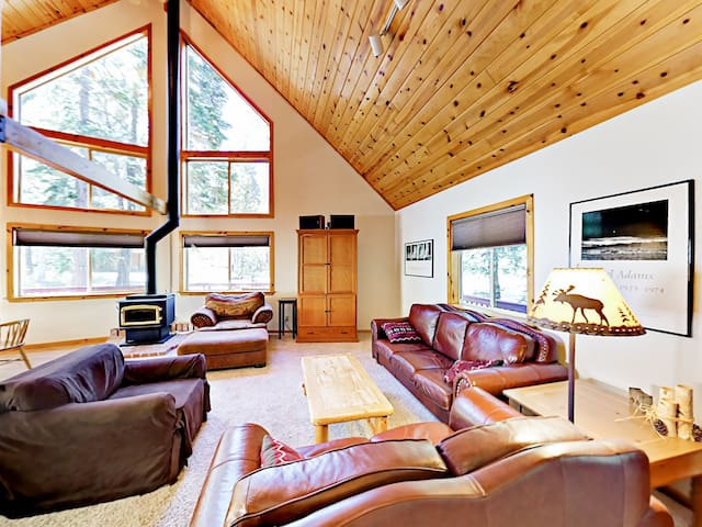 High ceilings and tall windows bring an airy atmosphere to the open-concept living room.