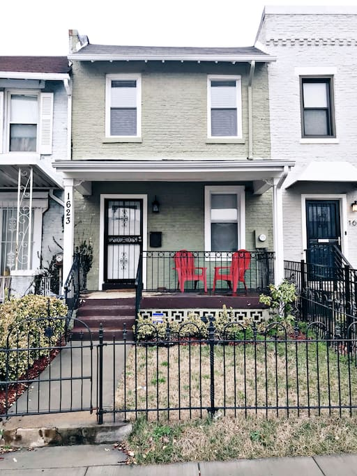 Welcome to our warm and inviting, newly-renovated row home in NE! Enjoy the front porch and fenced in yard.