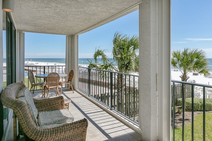 Sleek beachfront condo with beachside shared pool, private balcony and views!