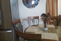 Dining table seats maximum of four.