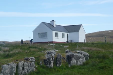 Tigh a' Bhaoghlach. (The Benbecula man's House)
