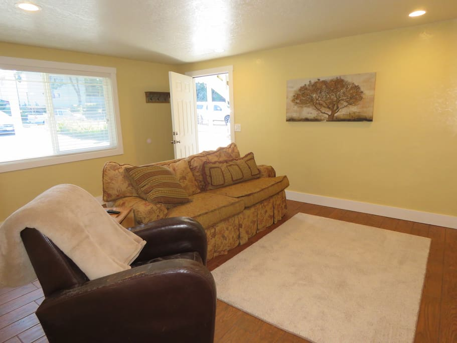 Spacious Living Room.  Opens up into dining room and kitchen.  Flat Screen 4K Smart TV. Unlimited Internet Access