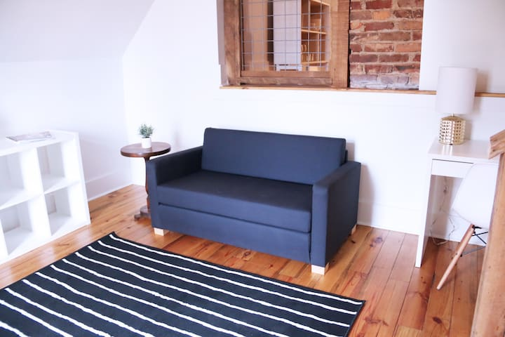 sitting area with sleeper sofa