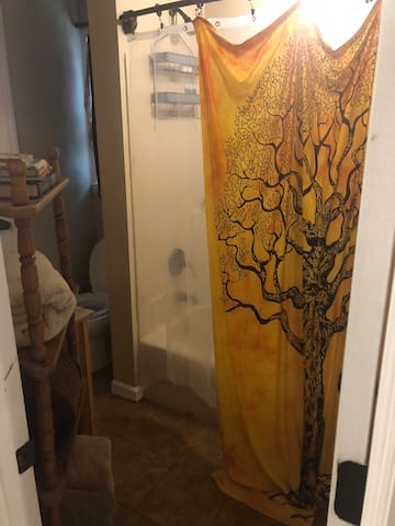 Full size, private bathroom with large shower.