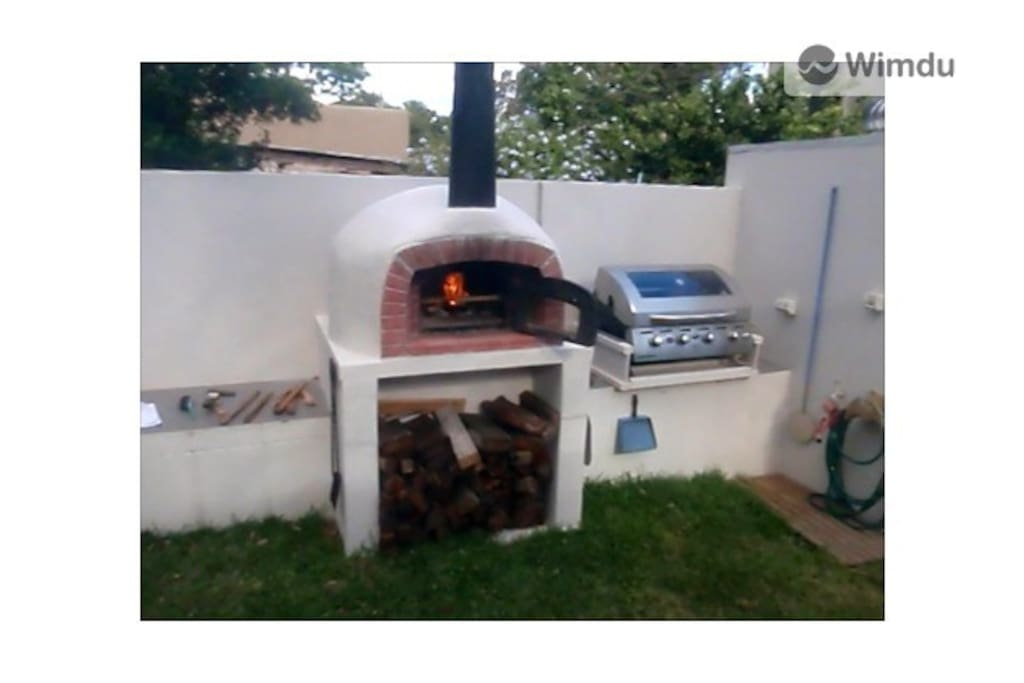 The Backyard Features a Woodfired Oven and Mains Gas Barbecue