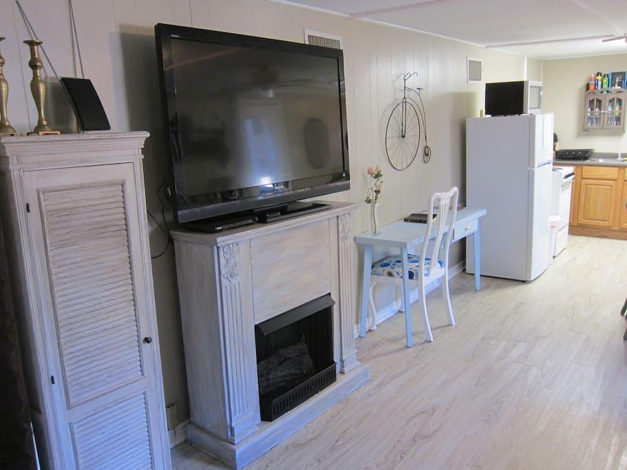 52 in smart tv with Roku, dvds , fan, little kitchen