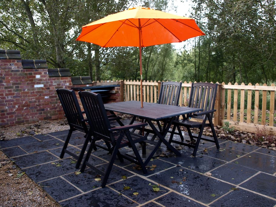 The patio area with built in B.B.Q and seating - plus use of grounds