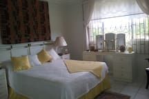 queen size bed,ceiling fan, wide picture windows,fitted wardrobes.