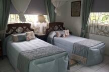twin room, mosquito nets, ceiling fan, fitted wardrobes,well ventilated with wide picture windows.