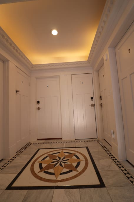 All the rooms open onto a tiled, marble hallway.