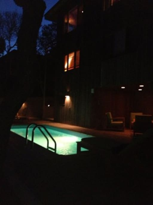 Pool deck at night. Covered lounge to the right.