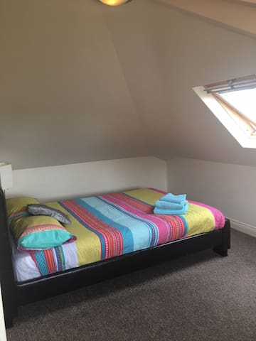 Bright spacious warm loft room big window lovely outlook in a quite residential area close to city centre , RVI,  universities, only five minutes on the bus, great location.