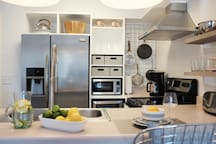 Fully equipped kitchen with wine cooler.