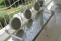 Rear veranda seating in garden setting