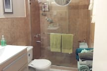 bathroom with double shower and vanity