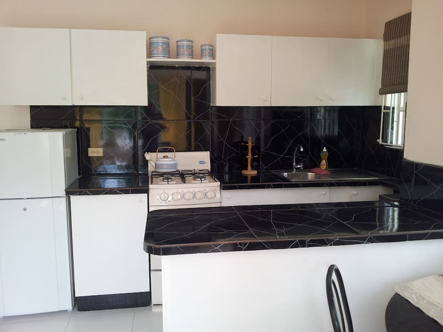 Fully equipped kitchen with cooker, fridge, crockery and cutlery