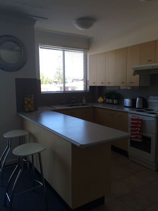 Open plan kitchen leads onto living area, full use of kitchen amenities, fridge, freezer, oven, stove, microwave